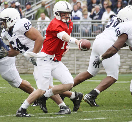 UNIVERSITY PARK, PA - APRIL 24: Penn State quarterback Matt McGloin #11 hands the football off at Beaver Stadium April 24, 2010 in University Park, PA