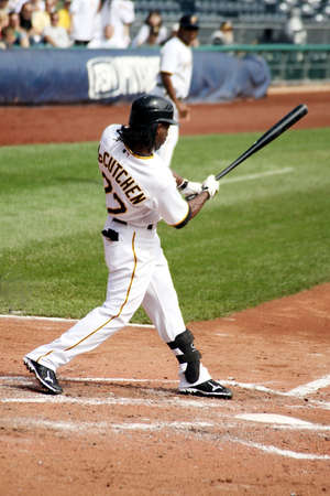 homerun: PITTSBURGH - SEPTEMBER 24 : Andrew McCutcheon of the Pittsburgh Pirates ducks on an inside pitch against the Cincinnati Reds on September 24, 2009 in Pittsburgh, PA.