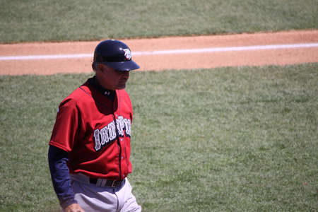 yankees: ALLENTOWN, PA - APRIL 29: Lehigh Valley Ironpigs manager Ryne Sandberg walks off the field in a game against Scranton Wilkes Barre Yankees the at Coca-Cola Field on April 29, 2012 in Allentown, PA.