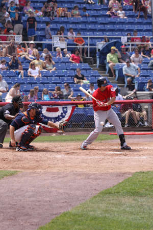follow through: BINGHAMTON, NY - JULY 7: Portland Sea Dogs batter Will Middlebrooks swings at a pitch in a game against the Binghamton Mets at NYSEG Stadium on July 7, 2011 in Binghamton, NY