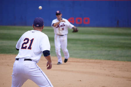 follow through: BINGHAMTON, NY - JUNE 14: Binghamton Mets Reese Havens throws to first base against the Reading Phillies at NYSEG Stadium on June 14, 2012 in Binghamton, NY