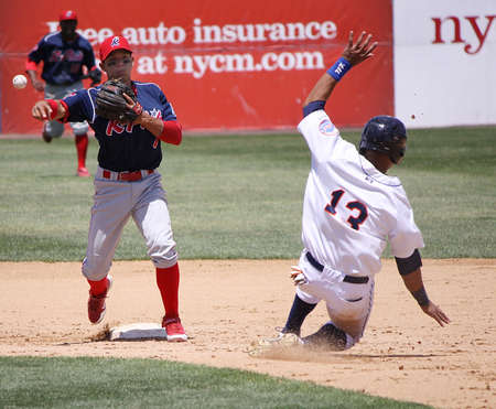 BINGHAMTON, NY - JUNE 14: Reading Phillies Cesar Hernandez completes the double play against the Binghamton Mets at NYSEG Stadium on June 14, 2012 in Binghamton, NY