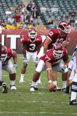 linemen: PHILADELPHIA, PA. - SEPTEMBER 26 : Temple Quarterback Vaughn Charlton calls the signals against Buffalo on September 26, 2009 in Philadelphia, PA.