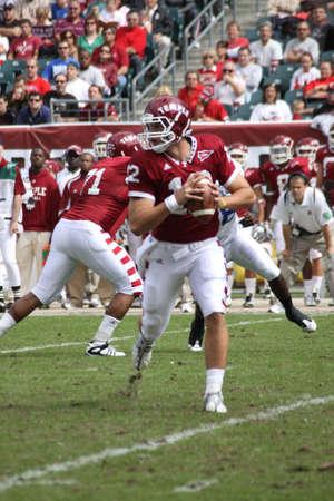 quarterback: PHILADELPHIA, PA. - SEPTEMBER 26 : Temple Quarterback Vaughn Charlton drops back to pass against Buffalo on September 26, 2009 in Philadelphia, PA.  Editorial