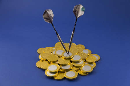 100 Dollar darts target on EURO on blue Stock Photo - 12092583