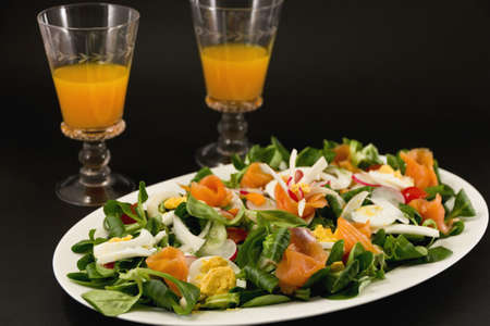 Healthy food- salmon and vegetable with orange carrot juice photo