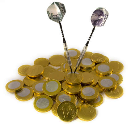 reveille: Dollar darts target on EURO coins Stock Photo