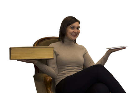 ereader: Young smiling woman compares e-reader and really heavy book