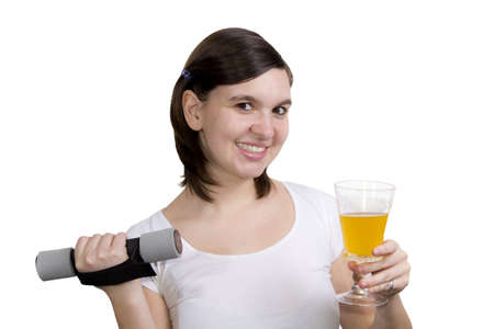 A healthy cute girl lifting weights and drinks orange juice, isoated  on white photo