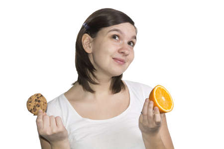 Cookie or orange - that is the question, isolated on white Stock Photo - 12760131