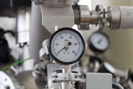 Manometers and valves – precise instruments in laboratory, close up photo