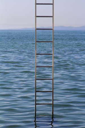 Ladder in vertical position the middle of the sea photo