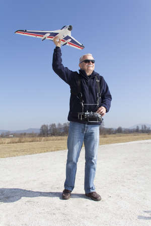 RC modeller preparing for launch new remote controlled  plane photo