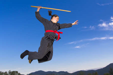 ninjutsu: Woman ninja flying with katana sword