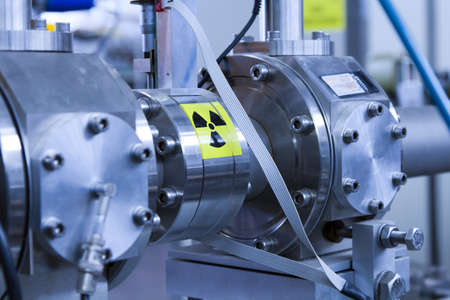 View of important electronic and mechanical parts of ION Accelerator, with high radiation sign, CNC machined parts Stock Photo - 13772926