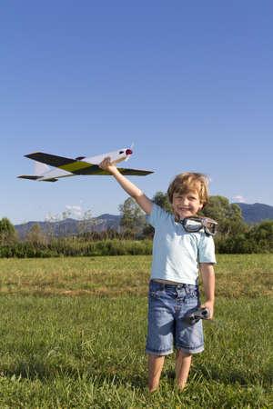 Smiling boy preparing to launch RC plane Standard-Bild