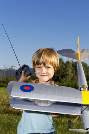 Smiling happy young boy and his RC plane photo