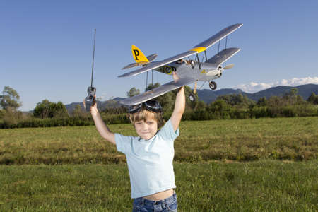 Smiling happy young boy and his RC plane