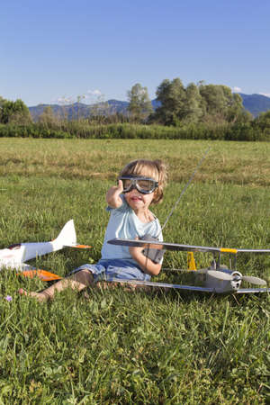 The little villain boy and new RC plane photo