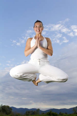 HIGH SPEED REAL SHOT   Young brunet girl performing Yoga - flying   floating   photo