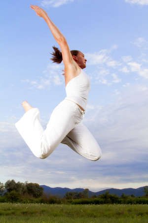 Young brunet girl performing Yoga - flying, floating   photo