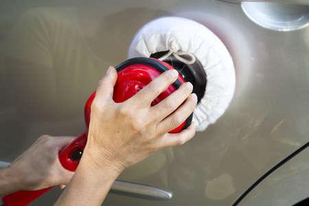 Polishing the car-closeup photo