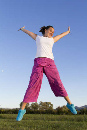cheerfull:  Cute smiling jumping girl in traditional asian fishermans pants