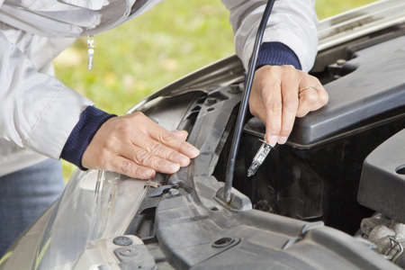 halogen: Changing halogen bulb in car headlight Stock Photo