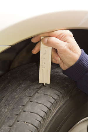 depth measurement: Measuring profile at the car tire with tread depth meter