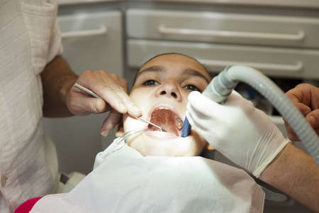 thorough: Dentist and his assistant carrying out a thorough dental examination Stock Photo