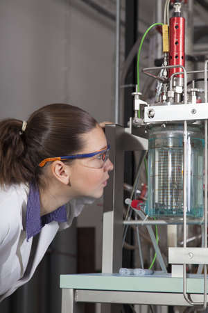 Cute chemist   researcher checking instruments in laboratory Stock Photo - 16119185