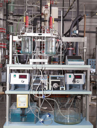 Close up of a laboratory equipment for destilation and various chemical experiments with precice electronic instruments photo