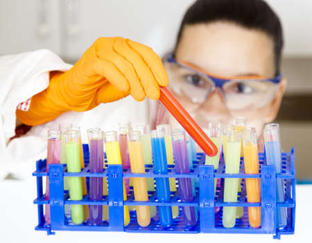 Cute medical or scientific researcher- chemist- scientist using test tubes  in a laboratory