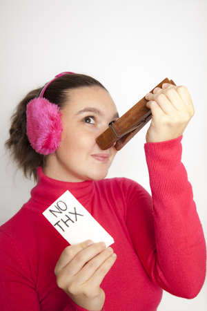 Cute young woman with giant clothespin on her nose, do not want to use handkerchief any more Stock Photo