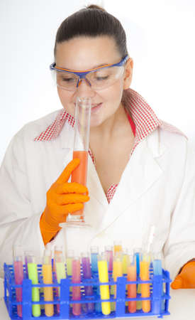 Cute food technologist,  chemist- scientist tasting and smelling juices and drinks in laboratory - selective focus