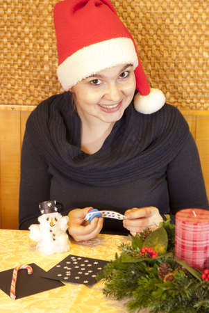 Cute smiling girl making cotton-wool snowman-selective focus  photo