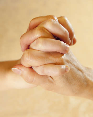 Conceptual image of young and mature people hands together photo