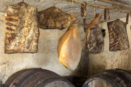 mustiness: Interior of very old wine cellar with dried meat delicatessen