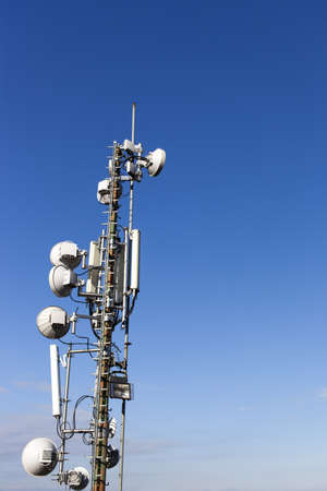 Telecommunication mast with microwave link antennas over a blue sky - space for Your text Stock Photo - 17310269