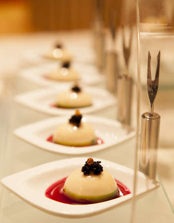 Finger food Fruits of the sea pudding with caviar photo