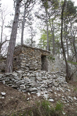 Herdsman stone house in the wood, shelter from the rain Stock Photo - 19318895