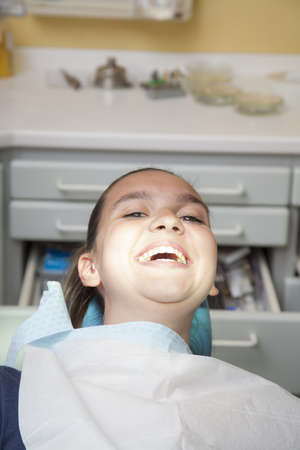 Cute smiling girl having her teeth checked by doctor Stock Photo - 19285214