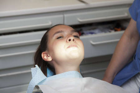 not open: Frightened girl at dentist-I will not open my mouth
