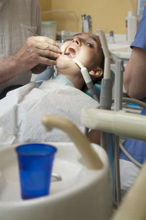 Cute girl having her teeth checked by doctor Stock Photo - 19285207