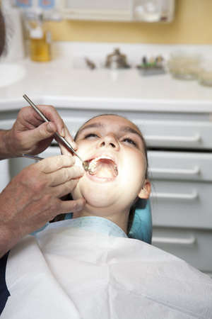 Cute girl having her teeth checked by doctor Stock Photo - 19285213