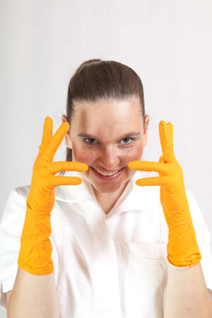 Female doctor surgeon or chemist wearing latex gloves  photo
