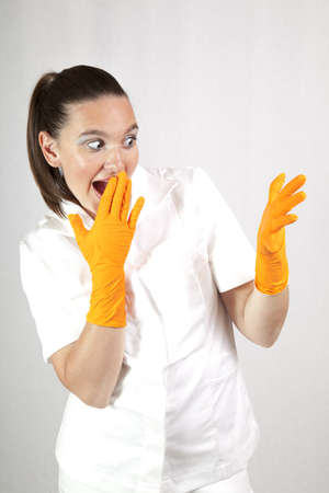 Cute surprised female doctor wearing latex gloves  photo