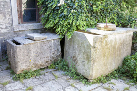depository: Stone containers for olive oil, traditional old depository for olive oil on Mediterranean islands
