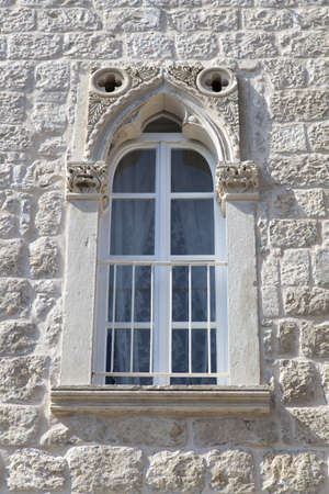 White renovated window in a natural stone Mediterranean house photo