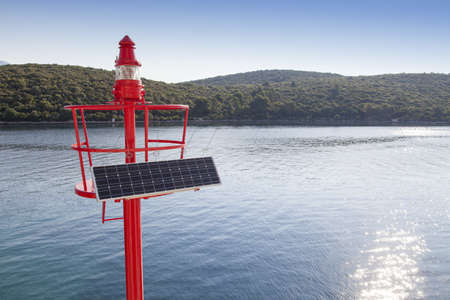 well equipped: Little Red beacon, equipped with solar cell panel and well visible lightning conductors Stock Photo